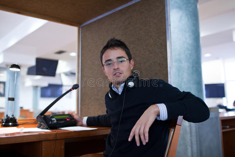 Interpreting -. Microphone and switchboard in an simultaneous interpreter booth royalty free stock image