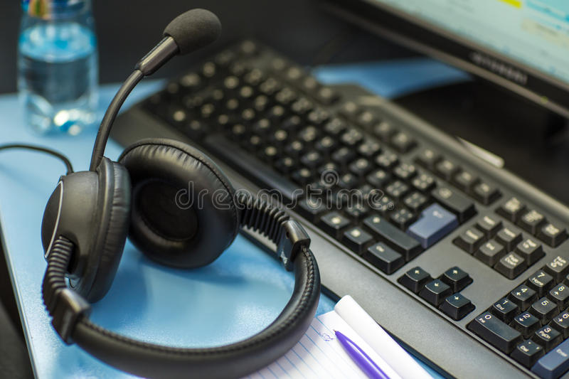 Interpreting - Headset with icrophone and a computer. Interpreting - Microphone and switchboard in an simultaneous interpreter booth (shallow DOF royalty free stock images