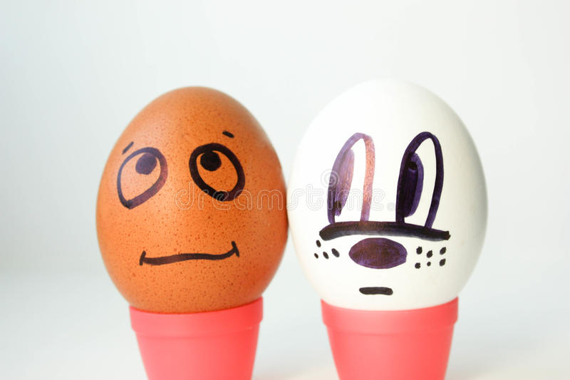 Interracial complexity of communication concept. Eggs with painted face. black and white. on a white background. Photo for your design royalty free stock photos