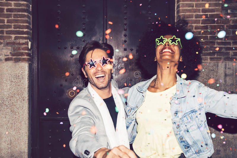Interracial couple making party outdoor in the night.  royalty free stock images