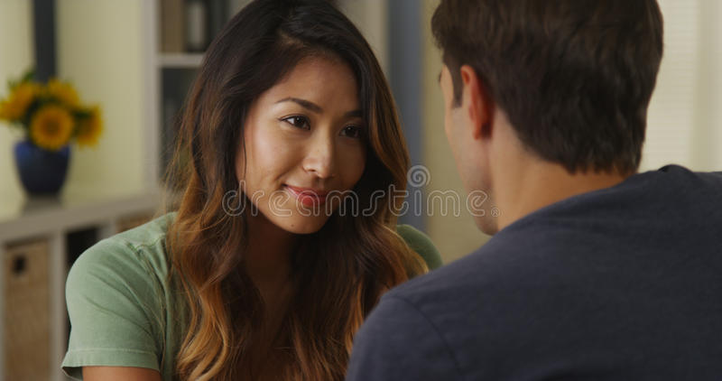 Interracial couple talking and listening royalty free stock photo