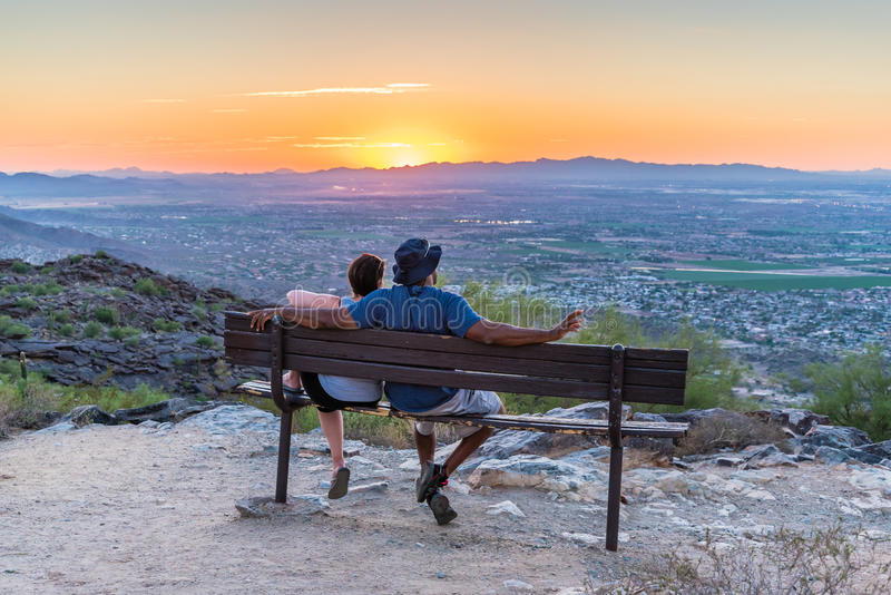 Interracial Couple Watches Sunset royalty free stock images