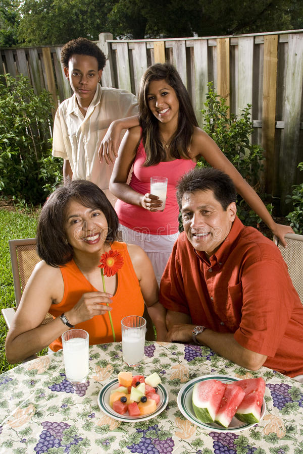 Interracial family in backyard stock images