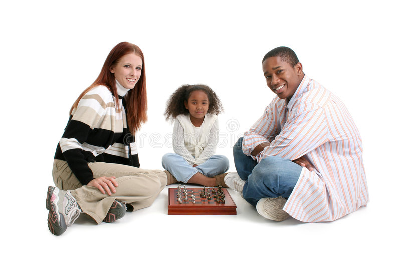 Interracial Family playing Chess. Mom, dad, daughter. Happy interracial family over white background. Playing Chess royalty free stock photos