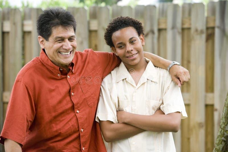 Interracial father and son royalty free stock photos