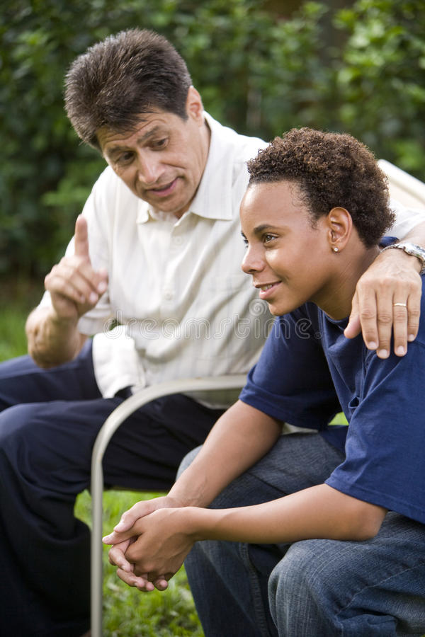 Interracial father and son royalty free stock images