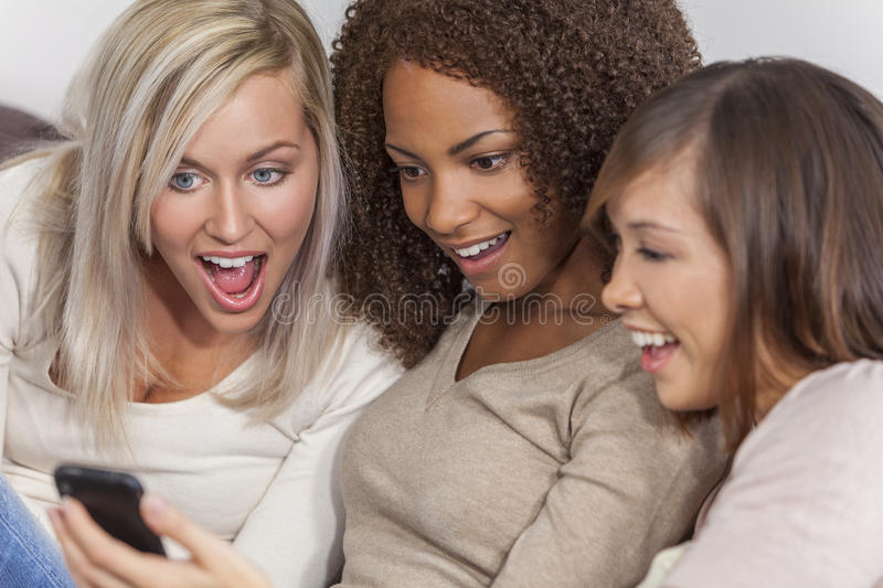 Interracial Group Beautiful Women Friends Using Smartphone royalty free stock images