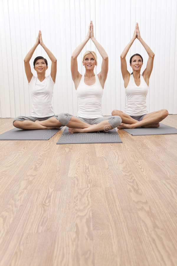 Interracial Group Beautiful Women In Yoga Position stock image