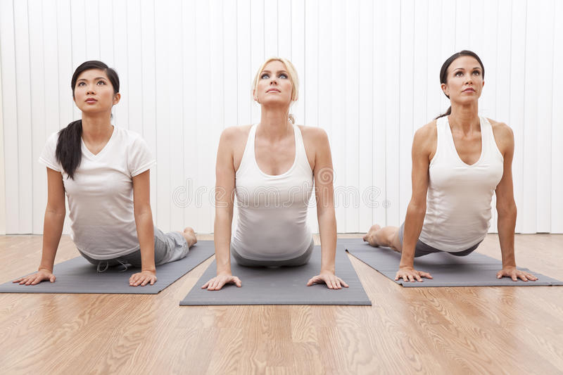 Interracial Group Beautiful Women In Yoga Position stock photography