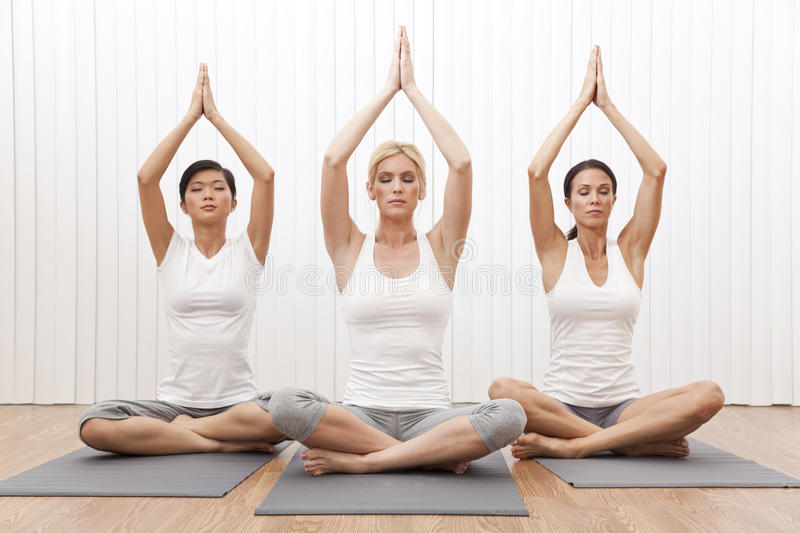 Download Interracial Group Beautiful Women In Yoga Position Stock Photo - Image: 23462400