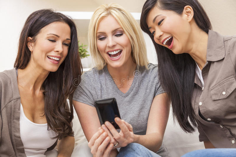 Interracial Group Three Women Friends Laughing Smart Phone royalty free stock images