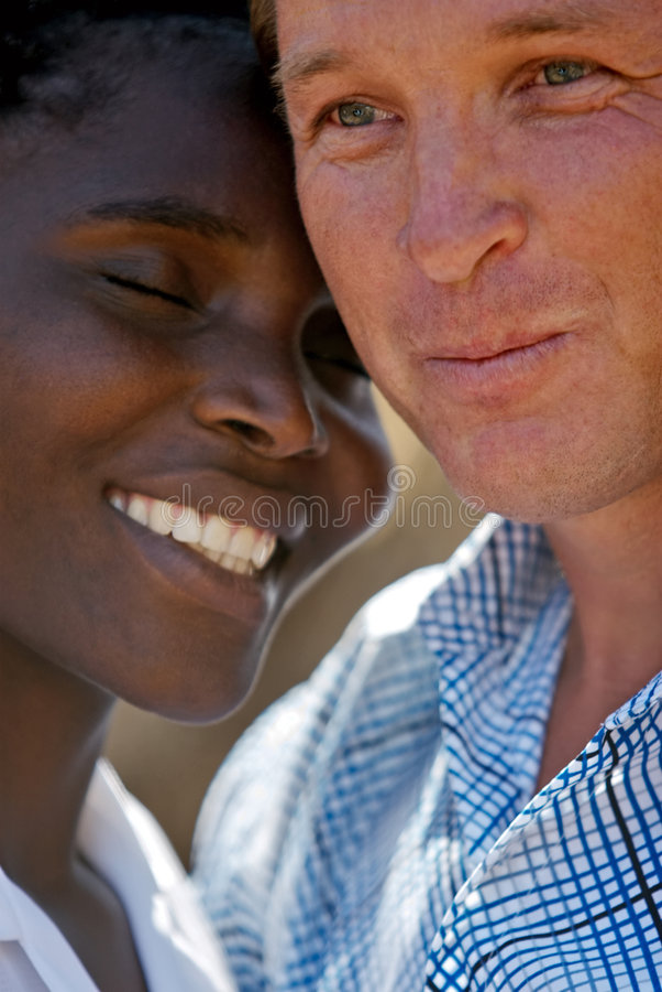 interracial stående för par royaltyfria foton