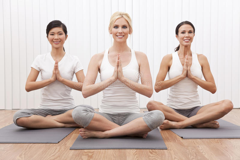 Interracial Yoga Group of Beautiful Women royalty free stock photography