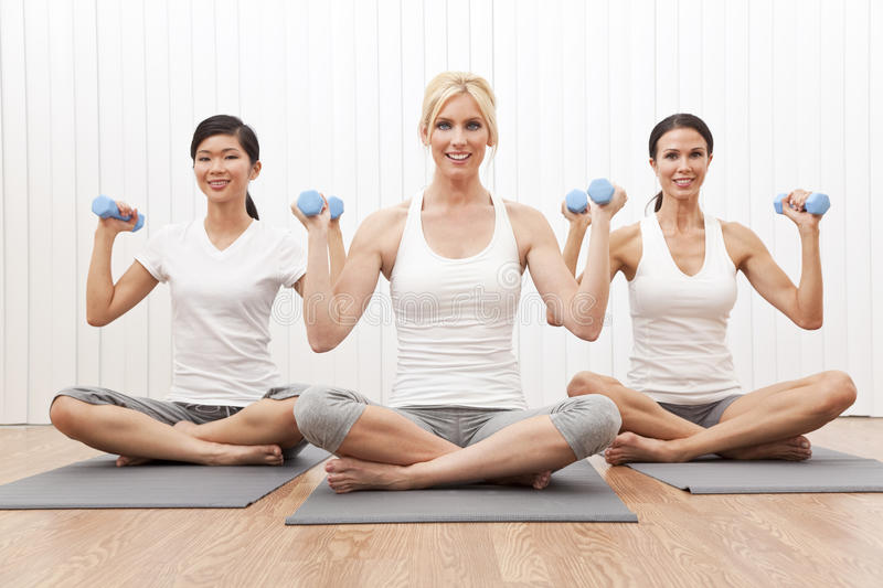 Interracial Yoga Group Women Weight Training stock photography