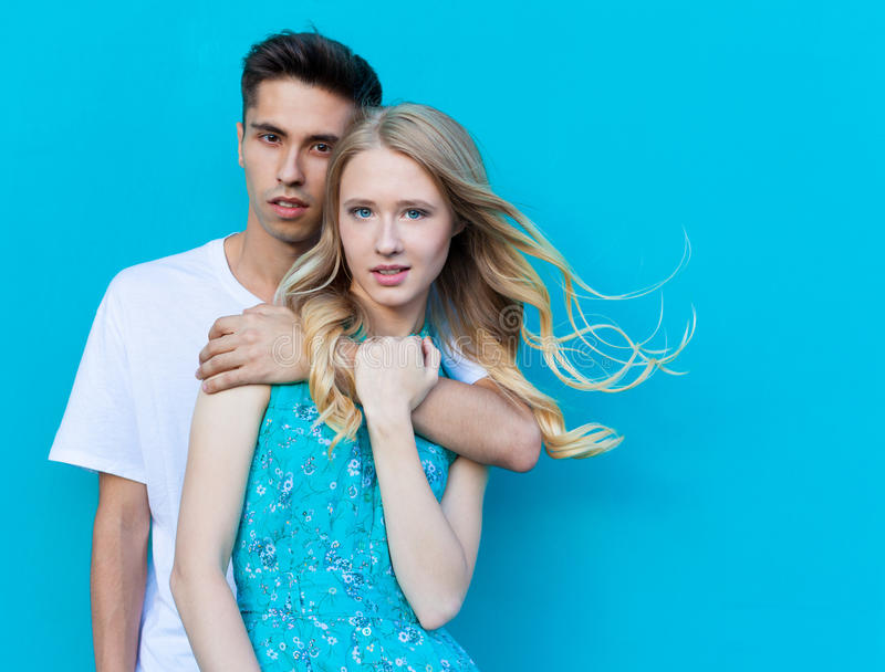 Interracial young couple in love outdoor. Stunning sensual outdoor portrait of young stylish fashion couple posing in summer. Interracial very young couple in royalty free stock photography