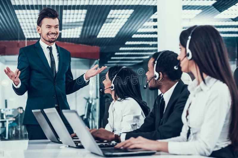Interracial young happy employees in call center royalty free stock photos