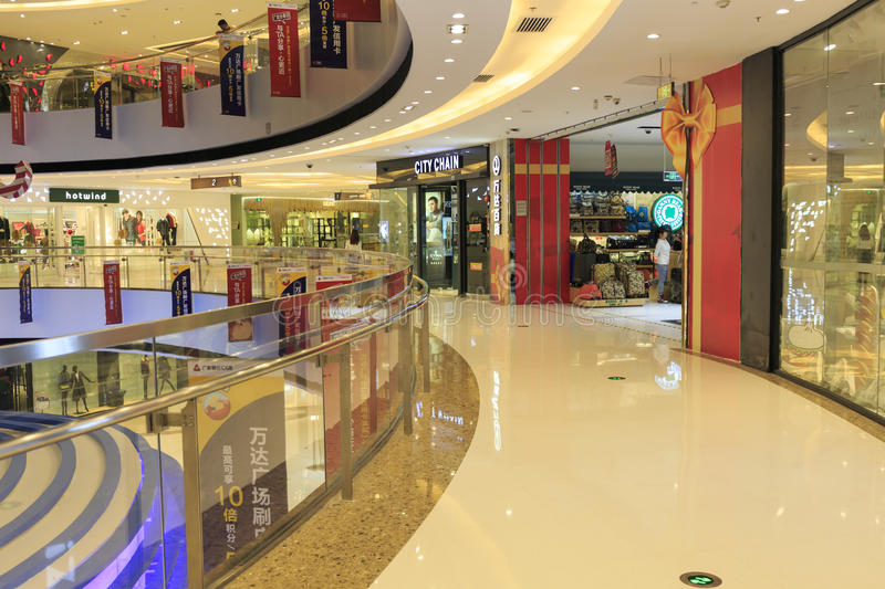 Shopping center. Interior of modern business commercial building. Inside city retail shopping mall center with stores and shops. Front of fashion shop store royalty free stock photography
