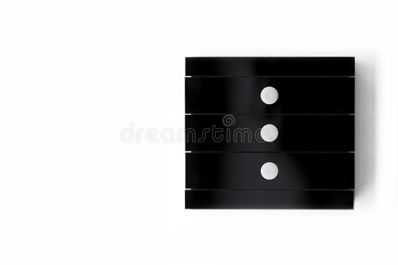 Interruptor da luz de vidro preto com três botões fotografia de stock