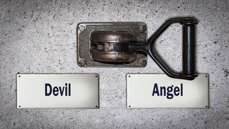Interruptor da parede ao anjo contra o diabo fotografia de stock