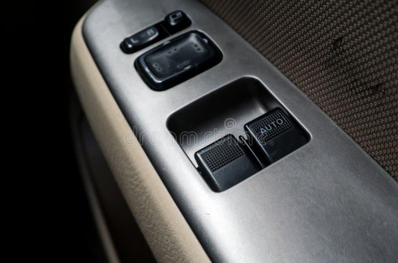 Interruptor de controle da janela de carro, com luminoso fotografia de stock