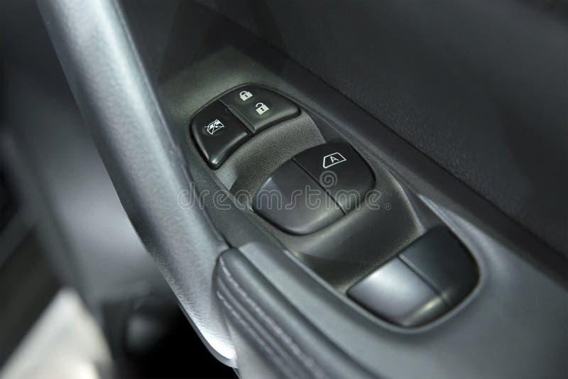 Interruptor de controle da janela de poder do carro fotografia de stock