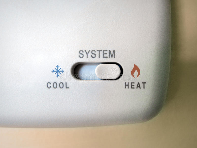 Interruptor fresco del calor del termóstato fotografía de archivo