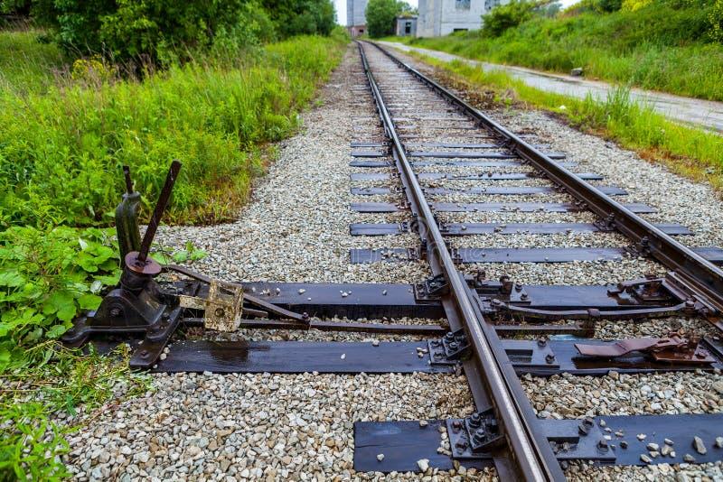 Interruptor manual del ferrocarril en la planta vieja imagenes de archivo