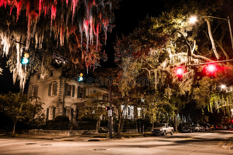 Intersection of Drayton and Gaston Streets at night in Savannah, Georgia. stock photos