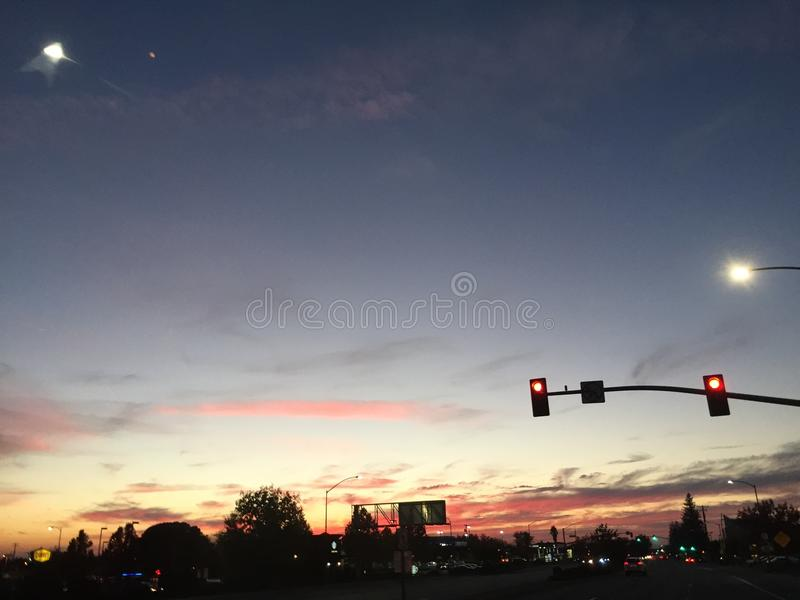 Intersection at Dusk with Sky and Moon Sunset royalty free stock photo