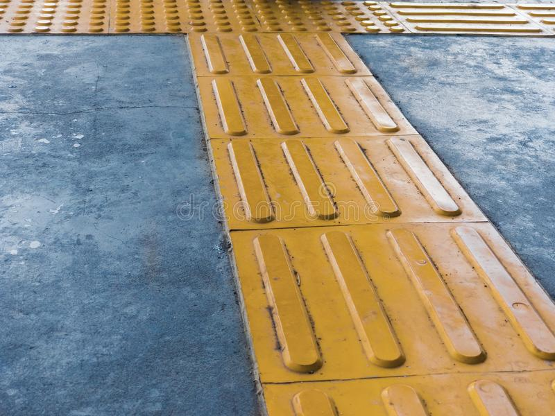 Intersection of Tactile Paving on Ground Surface as Guidance or Warning Sign To Help Visually Impaired or Blind Pedestrians. royalty free stock image