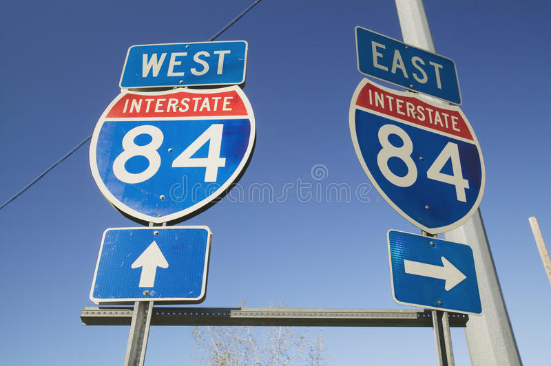 Interstate highway signs for East and West on Interstate Highway 84 stock image