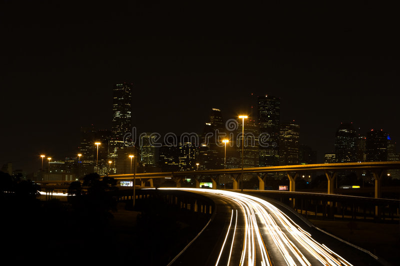 Interstate Highways And Downtown City At Night Stock Photos