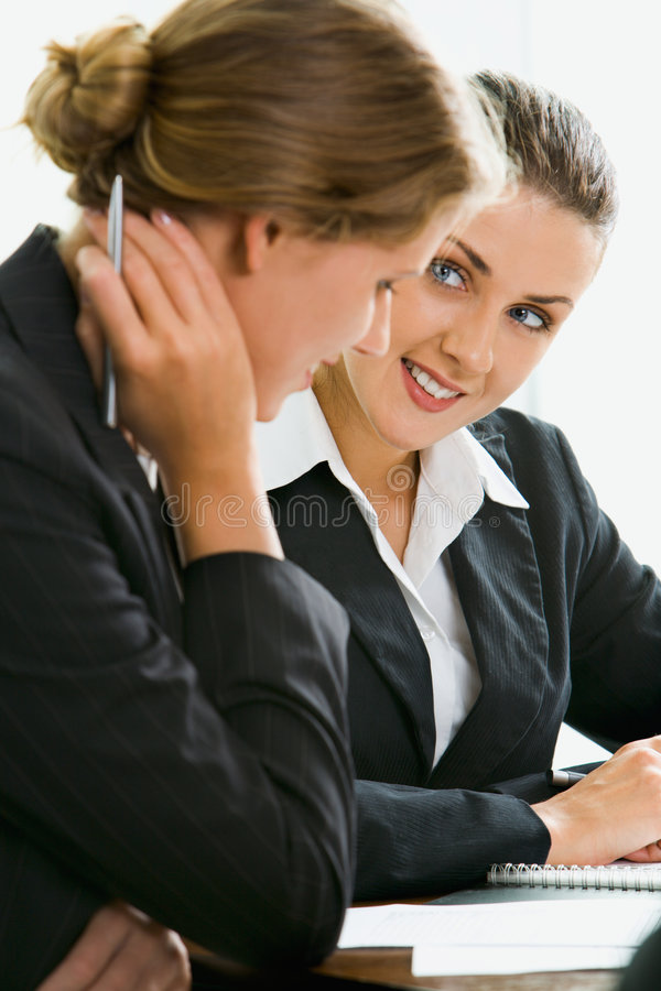 Interview. Young woman answers the questions of her potential employer