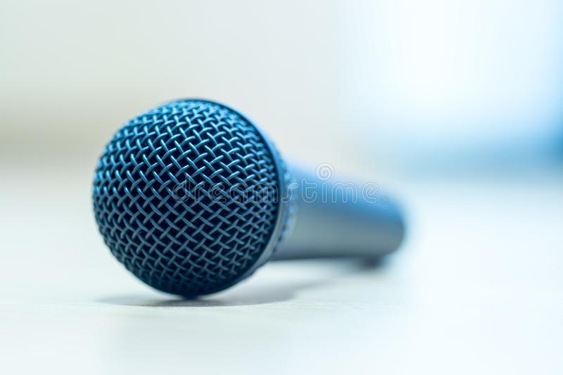Interview: Black microphone is standing on the desk, copy space stock images