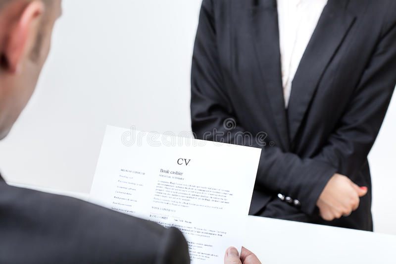 An interview. Candidate for a new job with his cv royalty free stock image