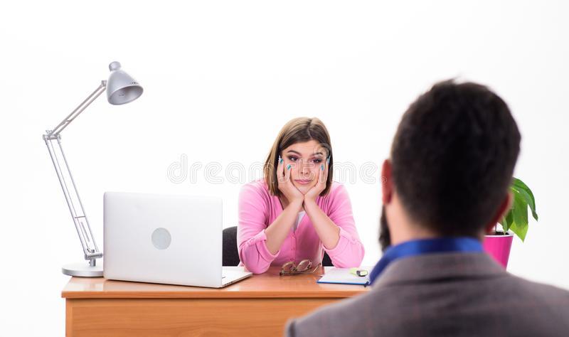 Interview for a job. Human resource manager conducting job interview with applicant. Pretty interviewer asking interview royalty free stock photography