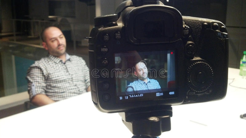 Interview. Of a man and a camera stock image