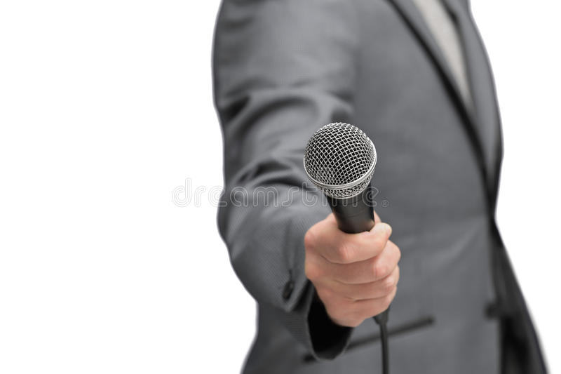 Interviewer or reporter with microphone in hand, mic stock images