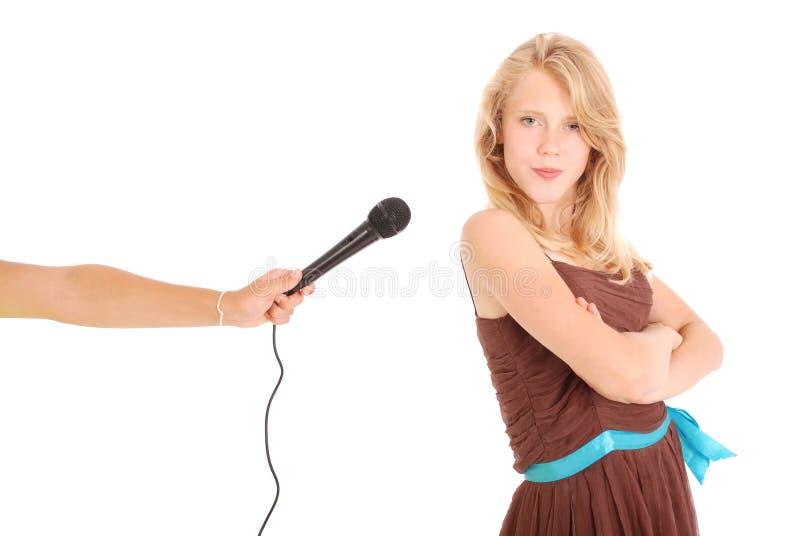 Intervjun för ` s för tonårs- flicka royaltyfria foton