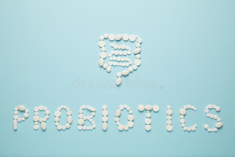 Intestines and pills, probiotics, antibiotics. Gut protection, recovery from illness and treatment.  stock image