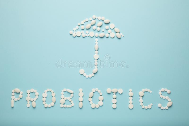 Intestines and pills, probiotics, antibiotics. Umbrella as a symbol of guts protection royalty free stock photo