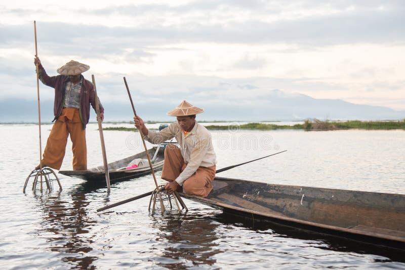 Intha fishermen working in the morning.Inle lake, Myanmar royalty free stock photography