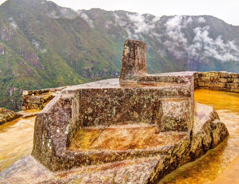Intihuatana lapident comme horloge ou calendrier astronomique par les Inca dans le siteCuzco archéologique de Machu Picchu, Pérou photo stock