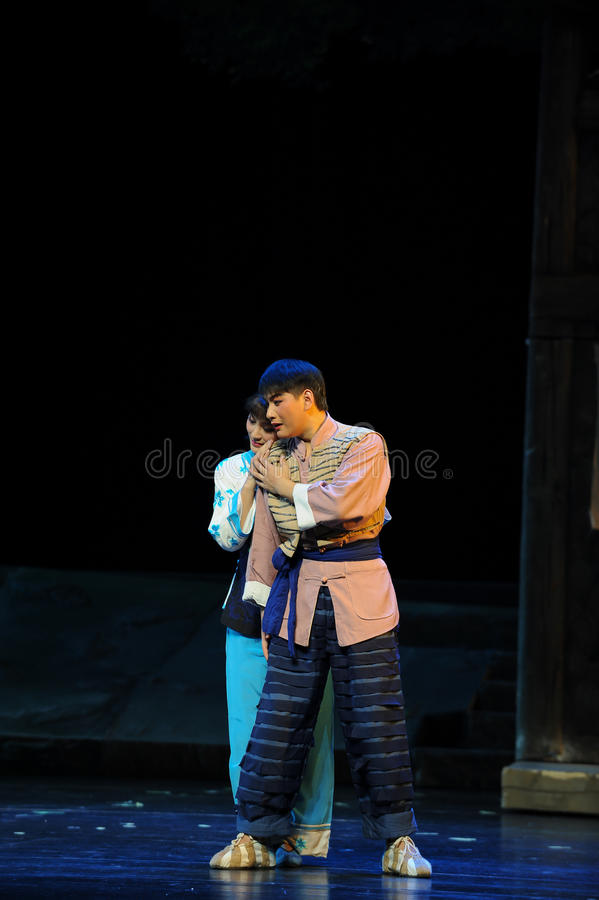 Intimacy- Jiangxi opera a steelyard. Jiangxi opera a steelyard is adapted from a true story: the last century fortys, the protagonists father runs an oil mill in stock photography