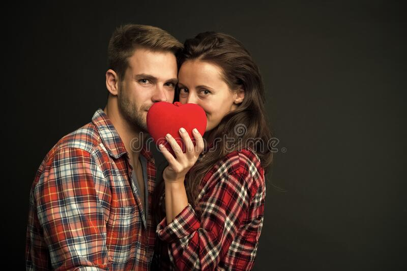Intimacy. Sensual couple red heart. Happy valentines day. Love and romance. Man and girl romantic date. Couple in love. Sexy couple checkered shirts copy space royalty free stock photos