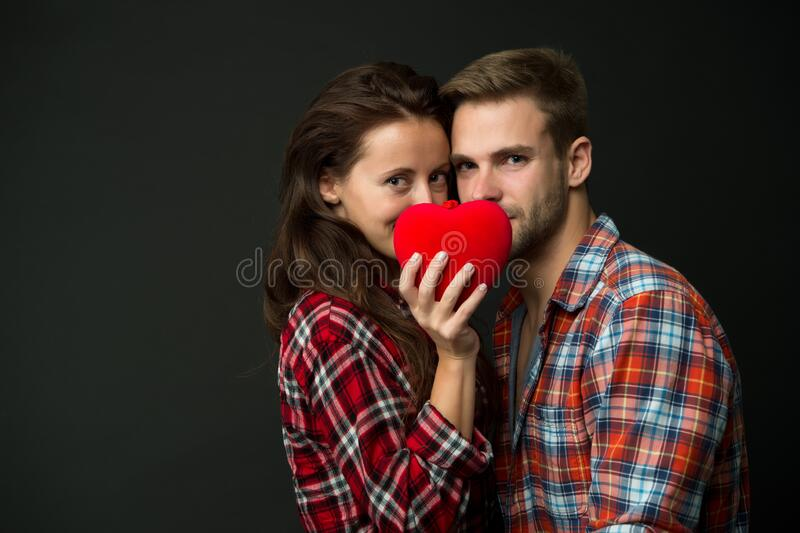 Intimacy. Sensual couple red heart. Happy valentines day. Love and romance. Man and girl romantic date. Couple in love. Sexy couple checkered shirts copy space stock image