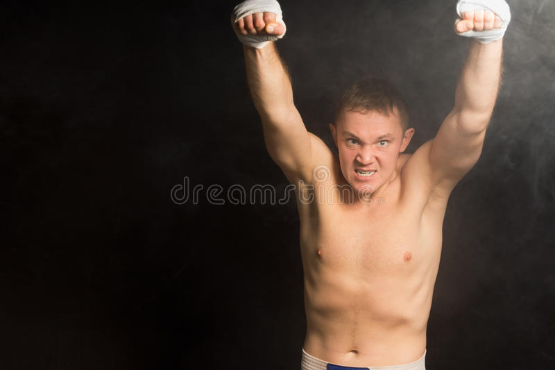 Intimidating nasty young boxer royalty free stock photography
