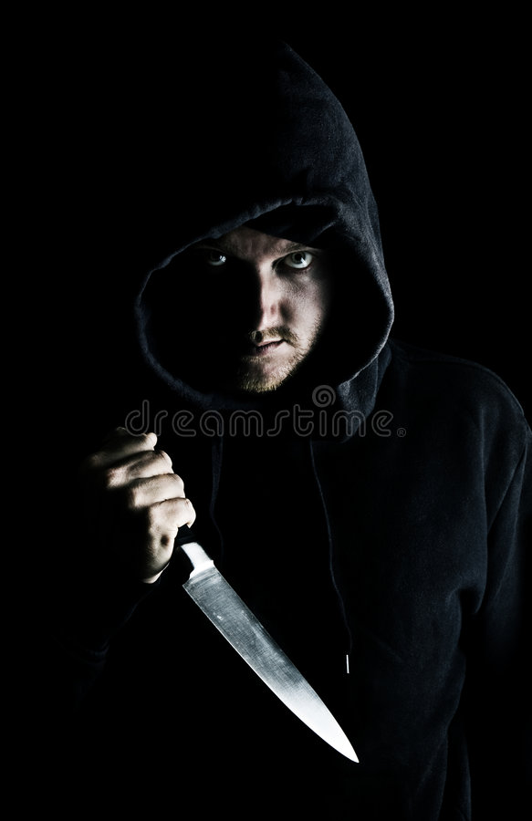 Intimidating Youth with Knife. Shot of an Intimidating Youth with Knife royalty free stock image