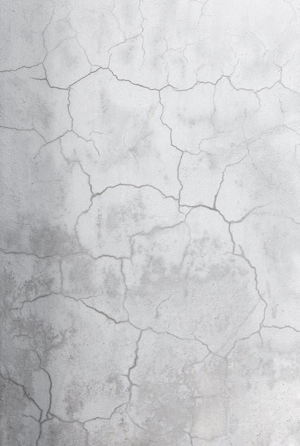 Intonaco incrinato Muro di cemento verticale fotografia stock