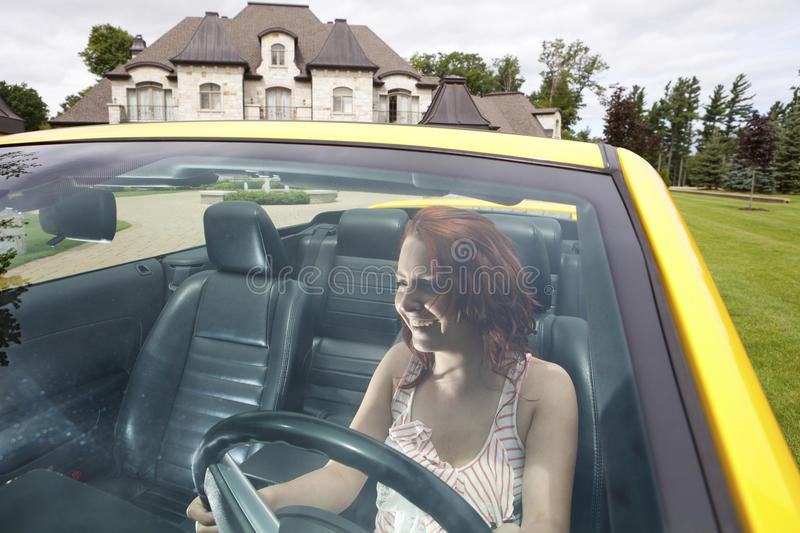Intoxicated young woman driving stock photos